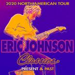 "Guitarist Eric Johnson stands in the middle of the image playing an electric guitar. The title, in front of him, reads ""Eric Johnson Classics: Present and Past"""