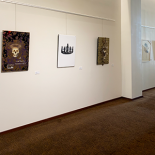 Four pieces of art by Gerry Lynch hang on the walls of the Betty Ray McCain Art Gallery
