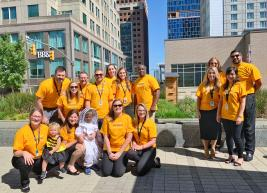 "Members of our team are posing arounf the new bee hive at the Raleigh Convention Center in matching ""Bee Day"" tshirts"