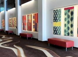 A photo of the Betty Ray McCain Art Gallery showing brightly colored art pieces hanging on the walls.