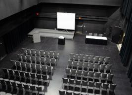 A view of Kennedy Theatre from above showing 2 multiple rows of chairs set up